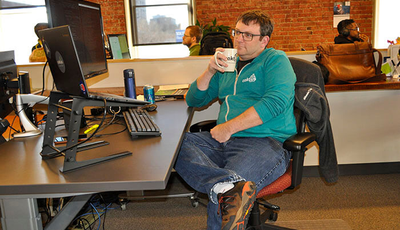 Developer Jeremy Gibson sits back for a moment at his desk.