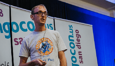 Carlton Gibson on stage during his presentation at DjangoCon.