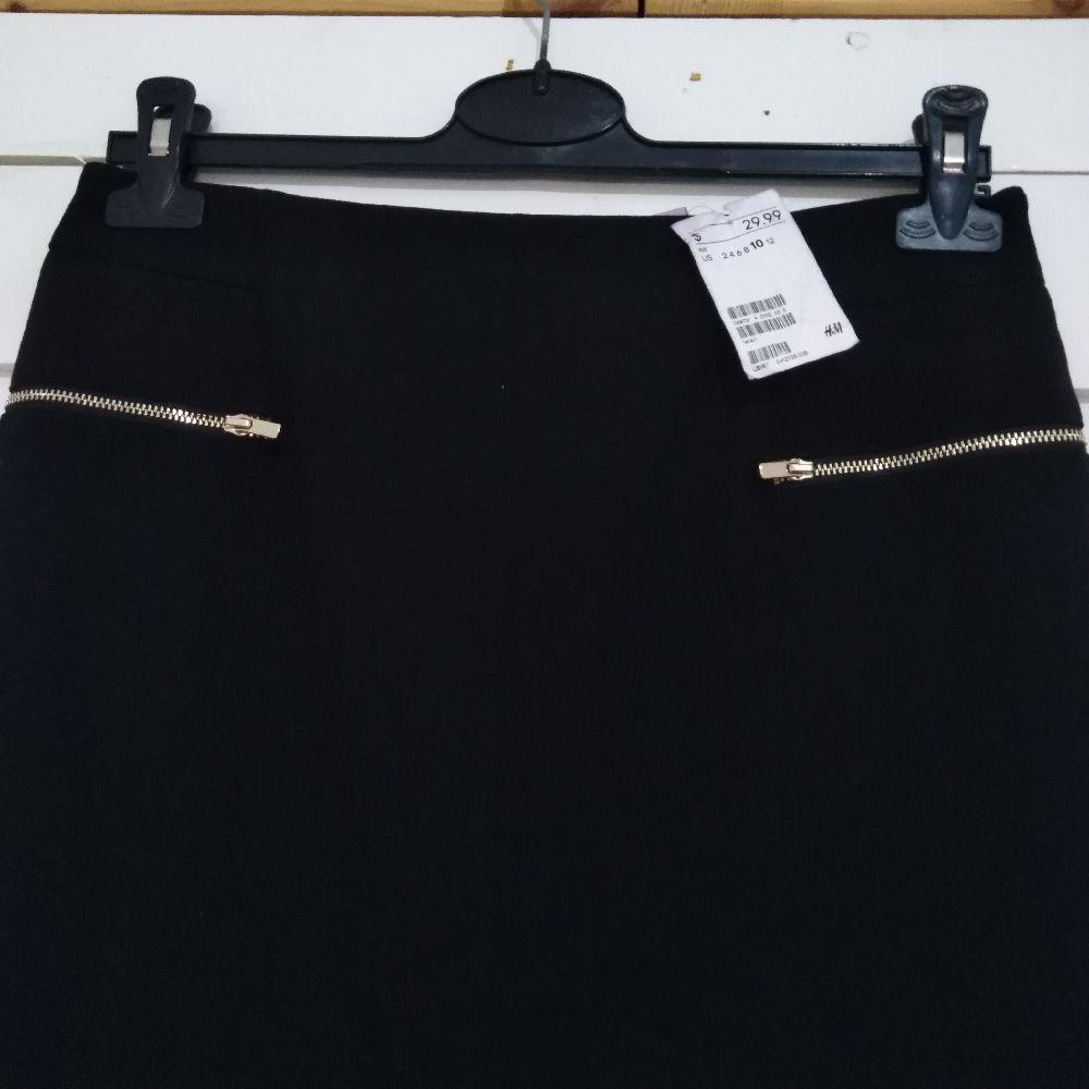 Très classe jupe noir midi