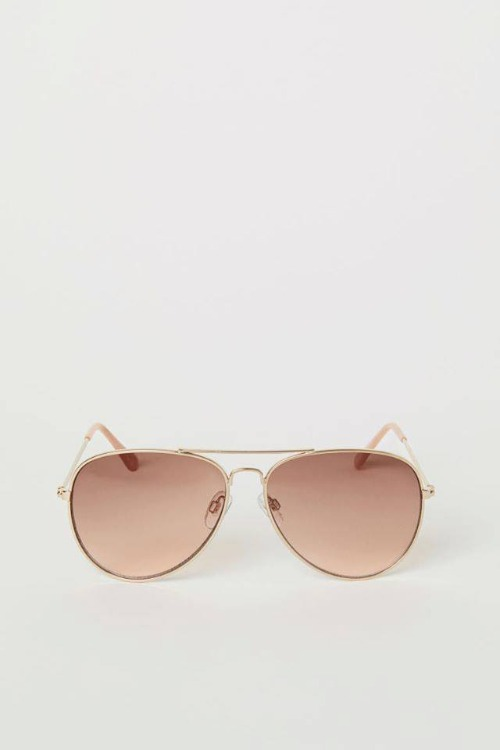 Aviator style sunglasses with metal frames and tinted lenses. UV-protective.