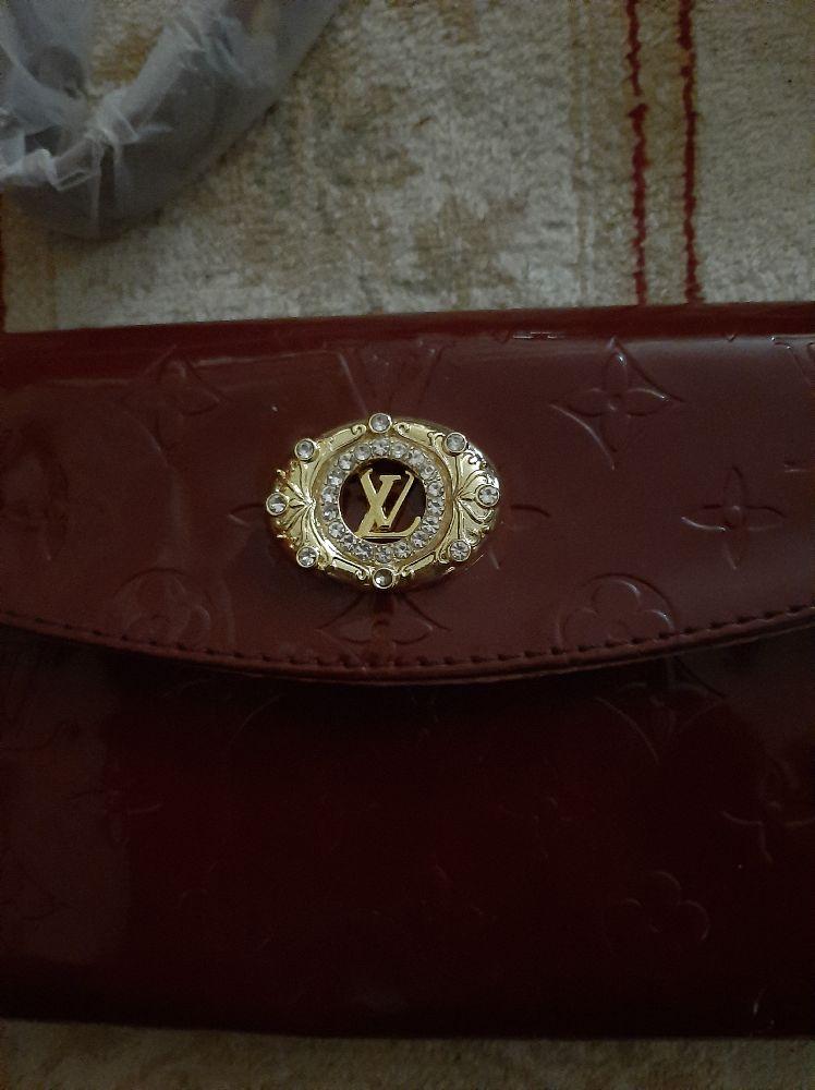 Pochette authentique neuve Louis Vuitton importée