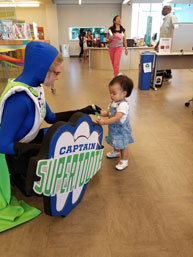 Big or small reading and brushing is fun for all !  The Captain at the Pioneer Library's  Summer Reading Kick Off Party
