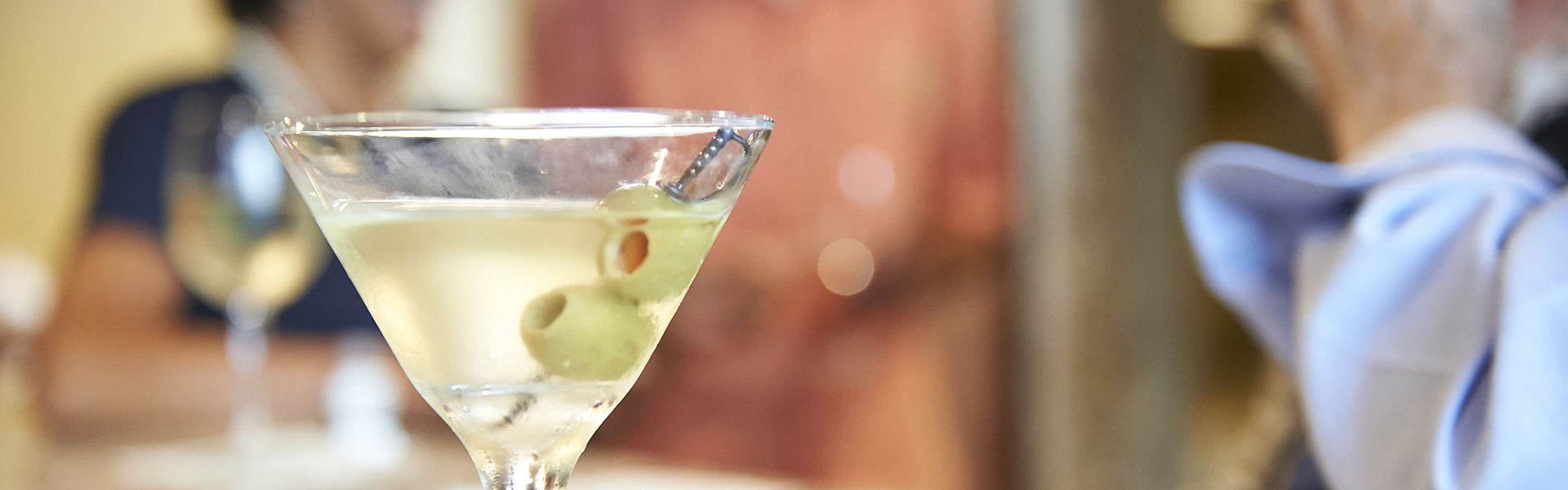 A martini with two olives