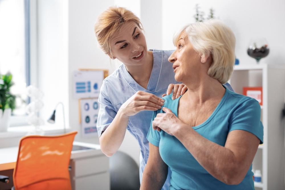 Senior woman talking with a nurse