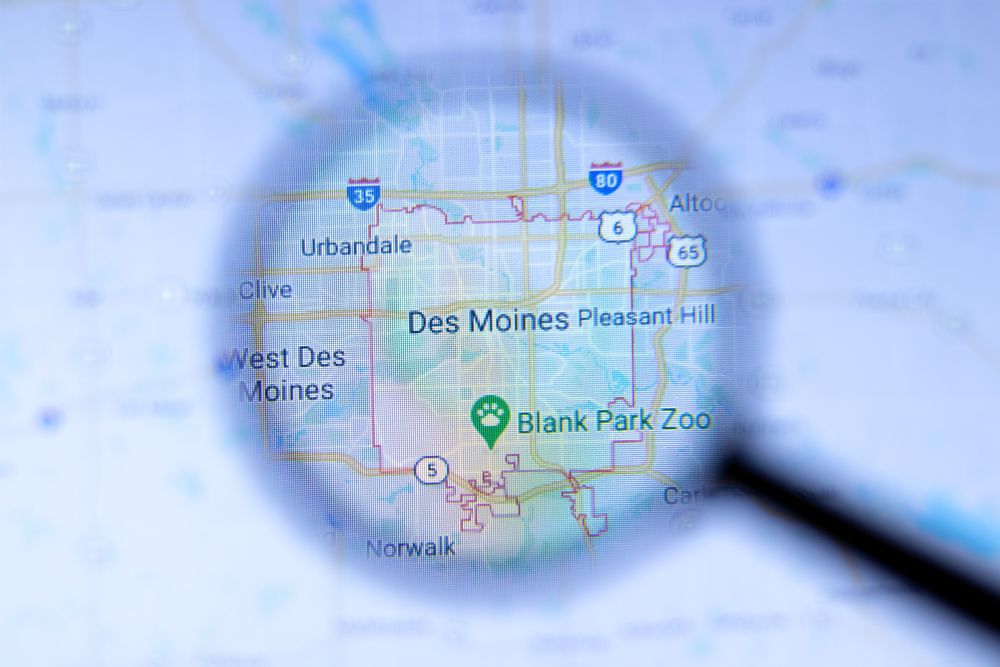 Magnifying glass on map of Des Moines, Iowa