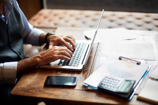 Senior man typing on a computer