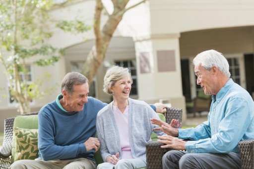 assisted living residents chatting outside their retirement community