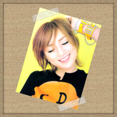 A photo of Ayumi Hamasaki taped to some wood board, demonstrating a possible outcome in GIMP