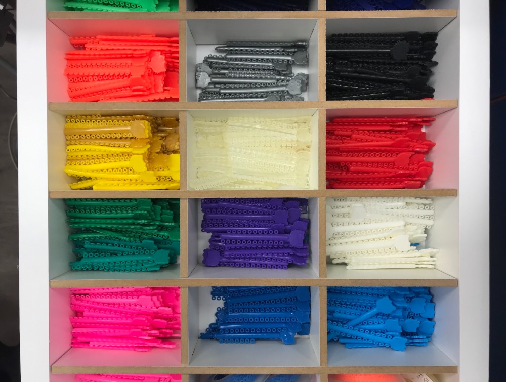 Box of colorful rubber bands