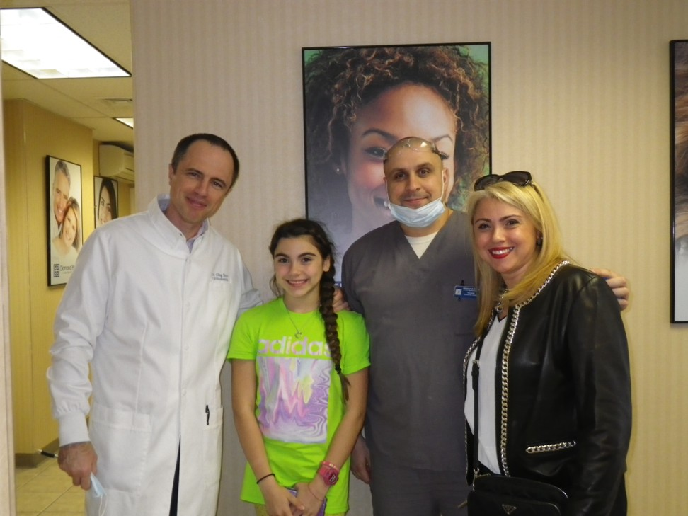 Julia and her mom smile with the Diamond Braces orthodontict team in Brooklyn!