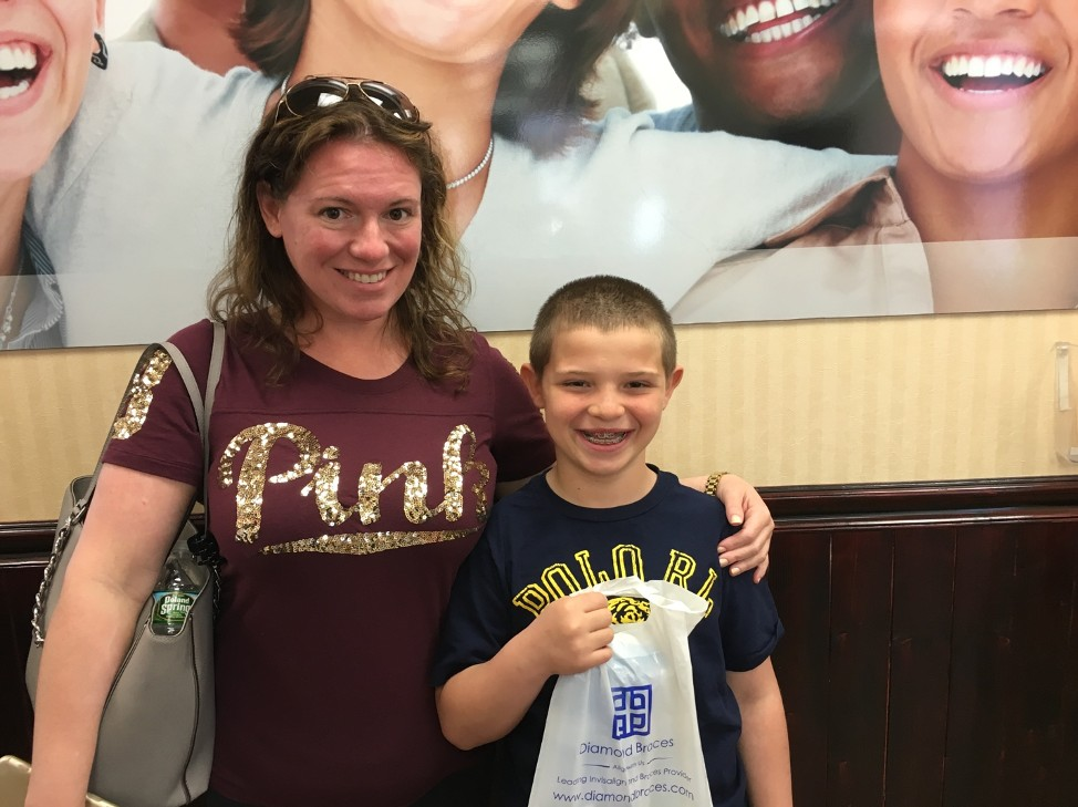 Kimberley and Son Matthew Smiling From Invisalign and Metal Braces by Edison Orthodontists Dr. Berk