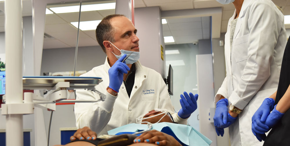 Orthodontist during braces treatment for patient in the East Village office NY