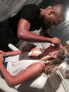 Nicck Townsend doing the brows of a client