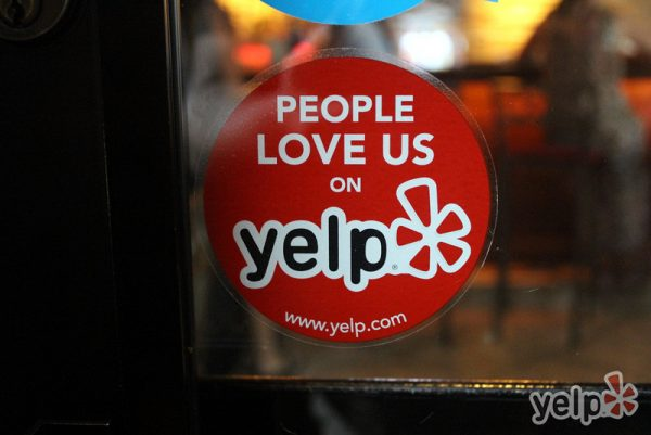 Posting Yelp stickers is a great tip for how to use Yelp to stand out