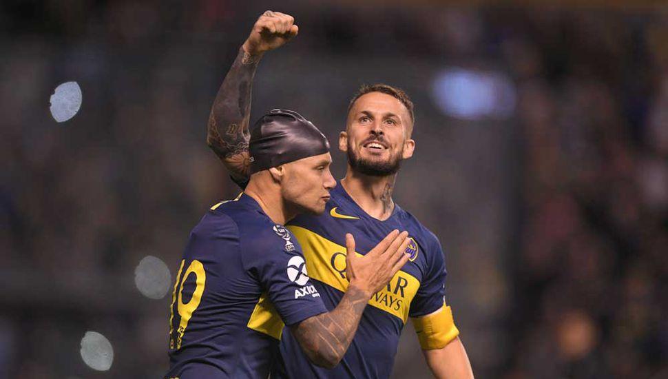 Zárate y Benedetto festejan el triunfo.