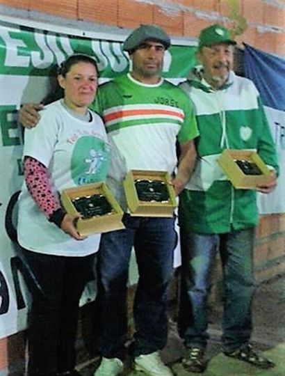 Los campeones 2016: Romina Dángelo, Jorge Arias y el juninense Rafael Mancera (derecha).