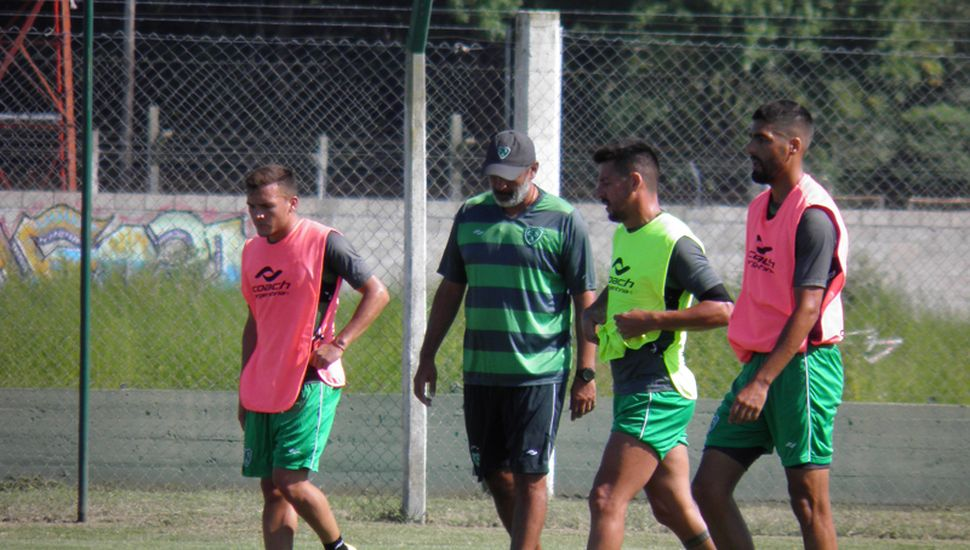 Martín García, Iván Delfino, Ariel Colzera y Fabio Vázquez, ayer, en Ciudad Deportiva.
