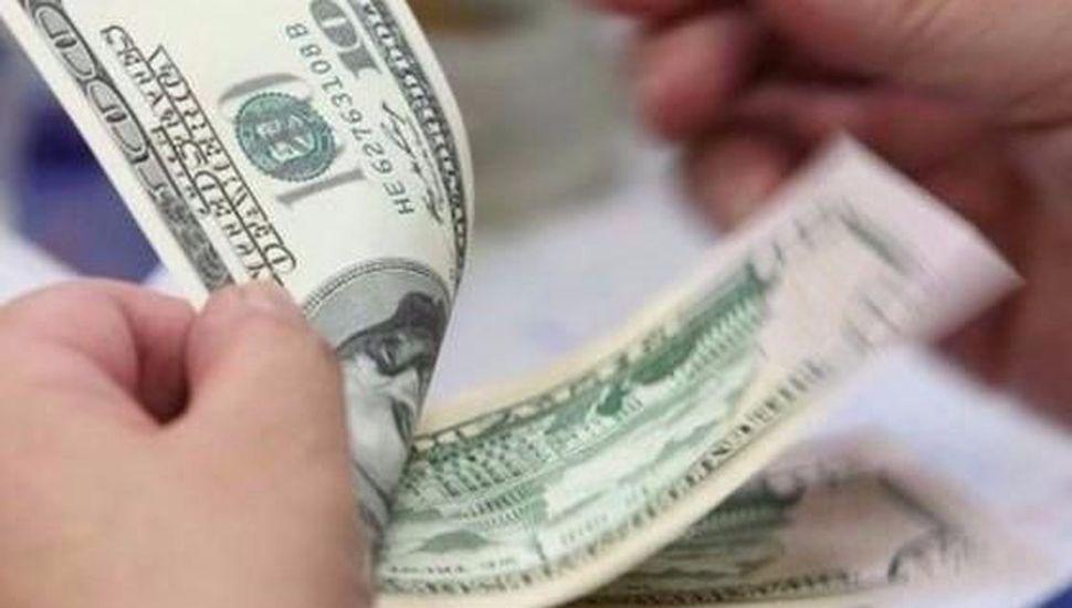 Esperan los dólares de la soja para calmar la sangría de divisas