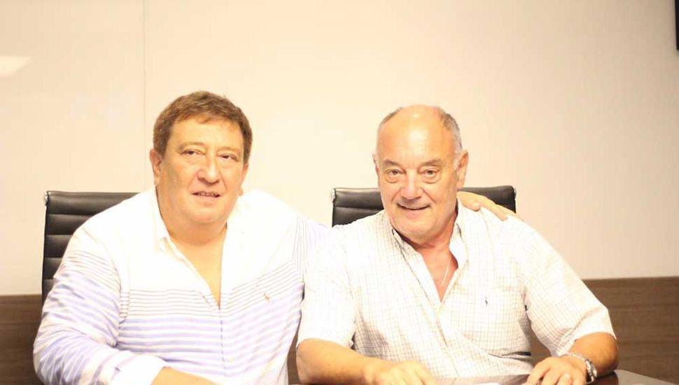 Fabián Borro y Miguel Chami, durante el acuerdo.