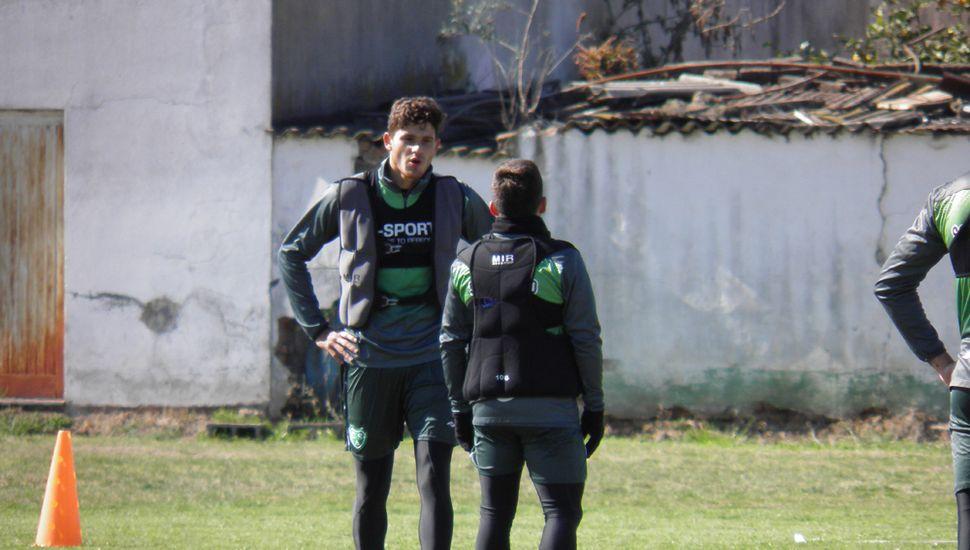 Juan Antonini junto a Sergio Quiroga (de espaldas).