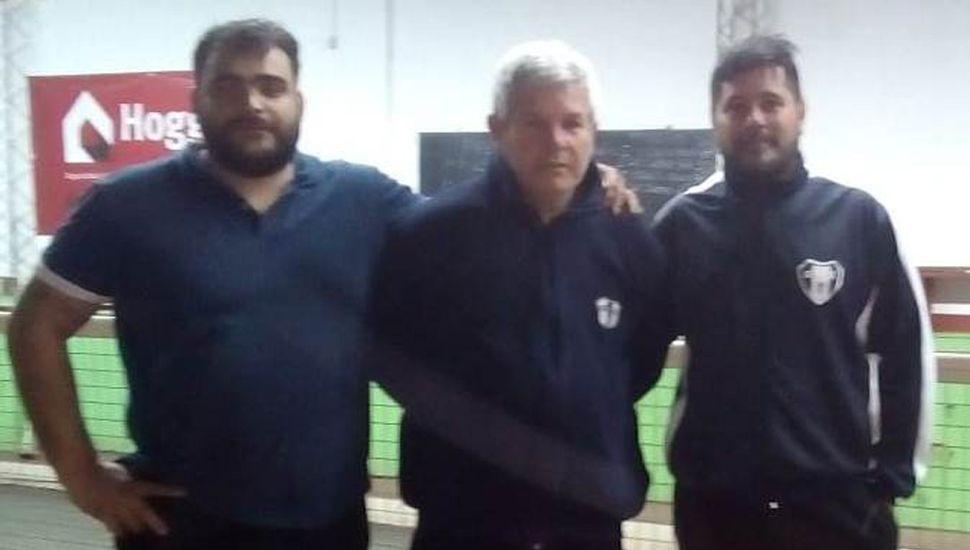 Leonardo Policritti (izquierda), Oscar Cañete y  Sergio Pérez, de Gimnasia, se coronaron campeones.