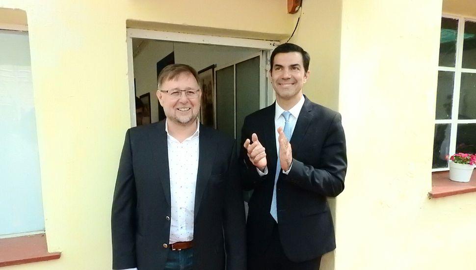 Juan Manuel Urtubey, junto a Oscar Romero.