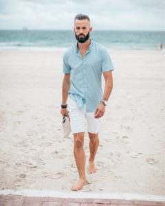 Michael Checkers wear white jean shorts and a light blue shirt on South Beach