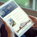 Real Estate Investment Trust Company website shown on iPad in a person's hands