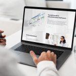Vitech Web Design shown with Man using a MacBook