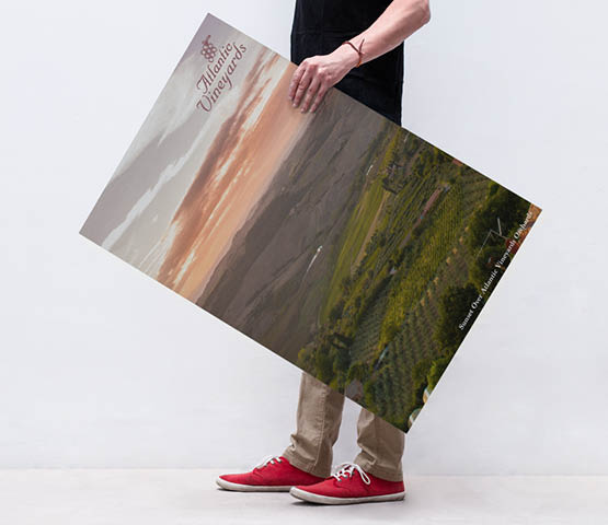 Man carrying a foamcore sign.
