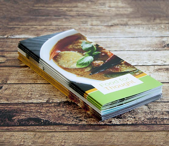 A stack of brochures for a culinary workshop.