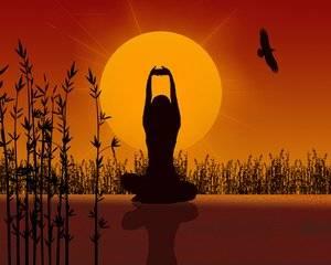 Femme en train de pratiquer la méditation, exercice de yoga qui diminue le stress.