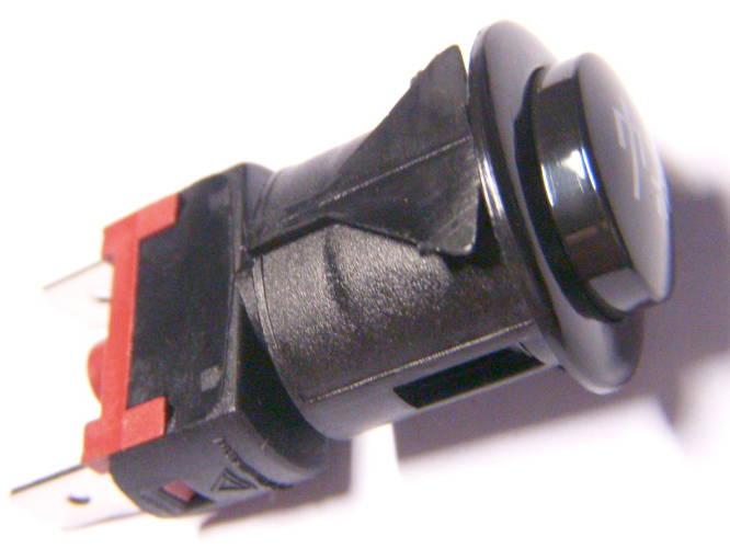 Черная овальная кнопка подсветки газовой плиты