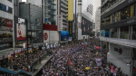 Dozens of leading Hong Kong democrats brace for national security charges