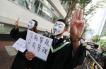 CUHK graduates march, chant protest slogans on campus after school cancels ceremony