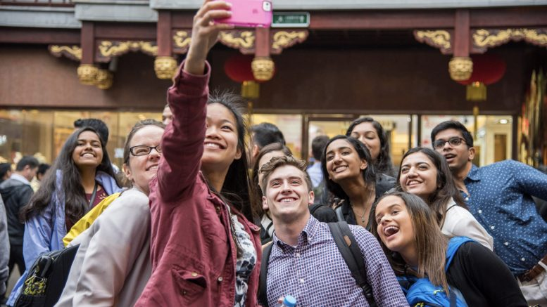 students take selfie while abroad