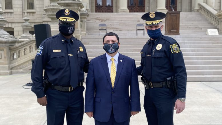 Ann Arbor Police Chief Michael Cox, Xavier DeGroat and U-M Police Chief Robert Neumann pose for a photo at the capitol.