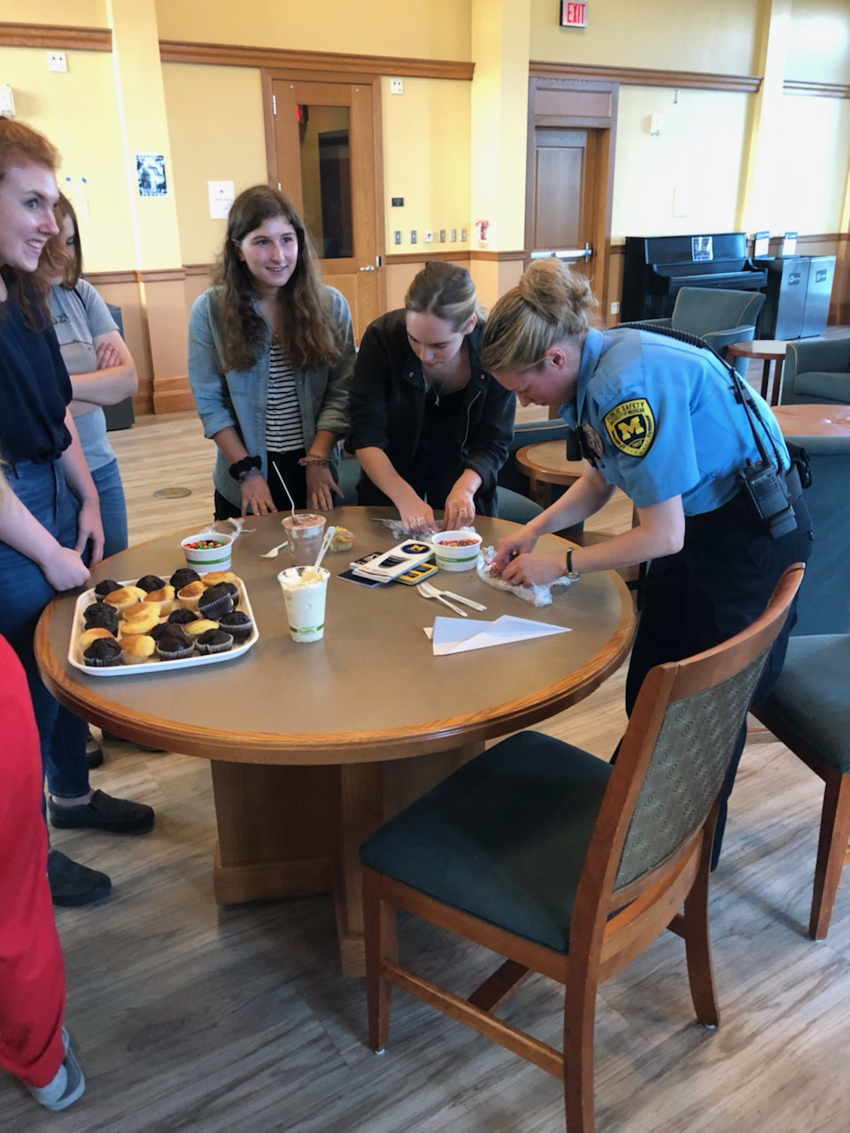Housing Security Officer talking to students in North Quad on May 9, 2019.