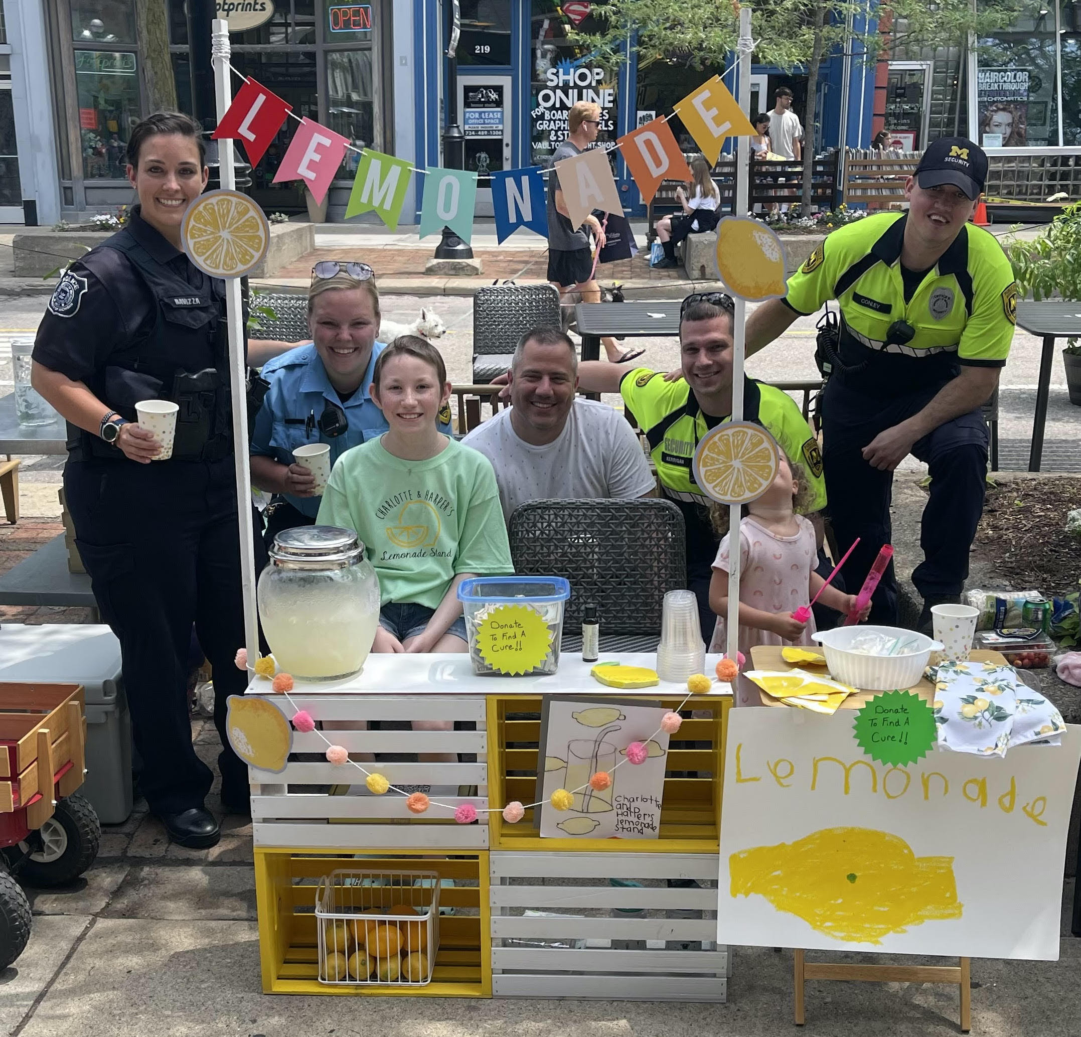 DPSS police and security officers stopped by to support our Ann Arbor Police colleagues and their children at their downtown Ann Arbor lemonade stand to raise money for childhood cancer on June 13, 2021.