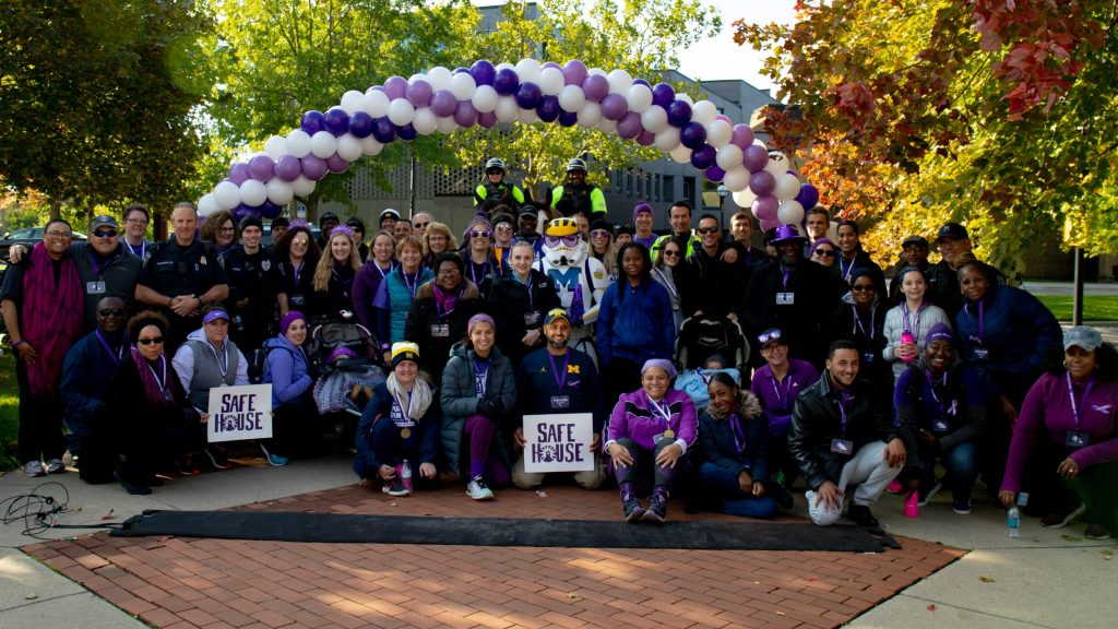 Participants and organizers at the 2018 Purple Run organized by SafeHouse Center, the Washtenaw County Prosecutor's Office, and DPSS.