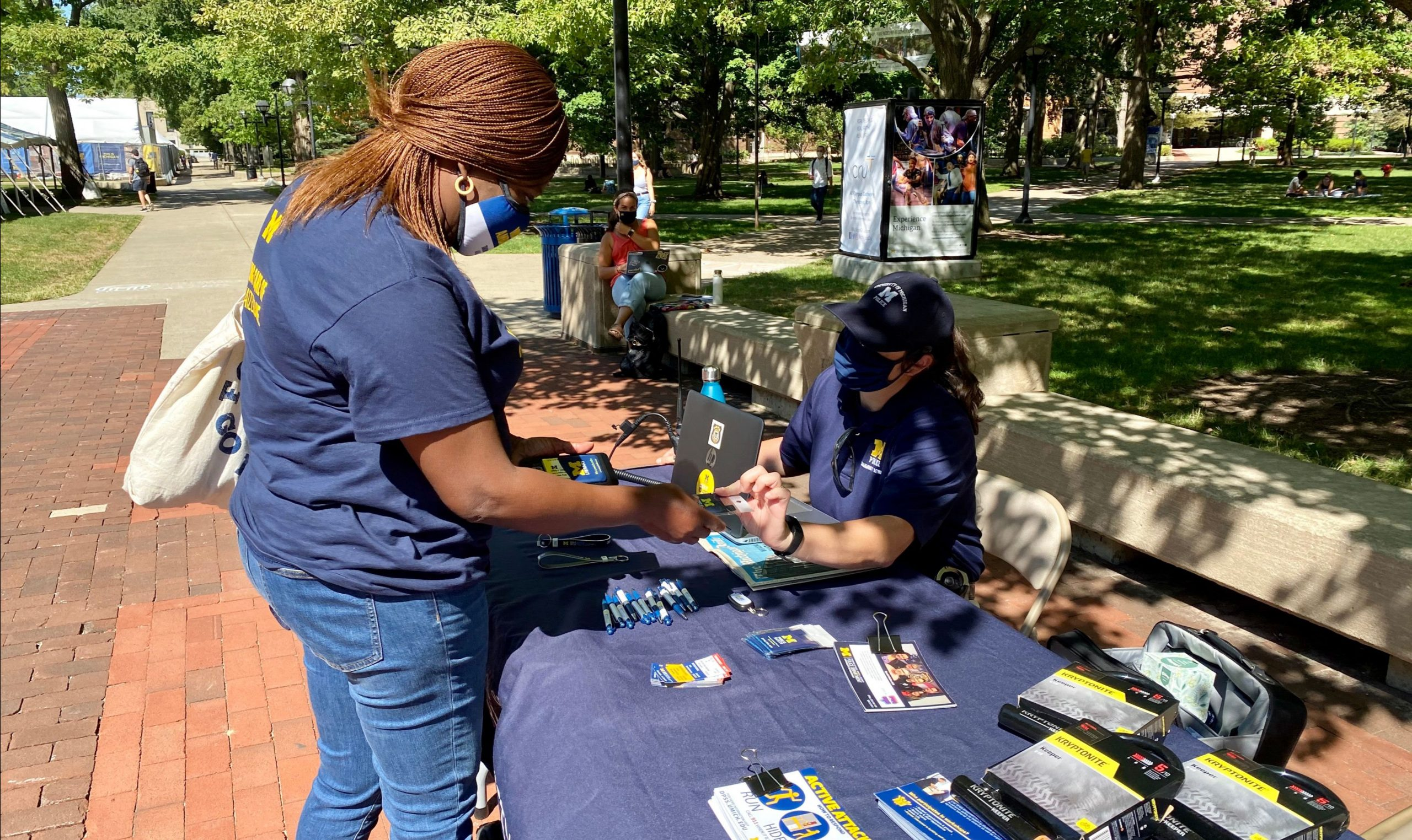 DPSS officer on the Diag registering personal electronics and bikes to help prevent theft.