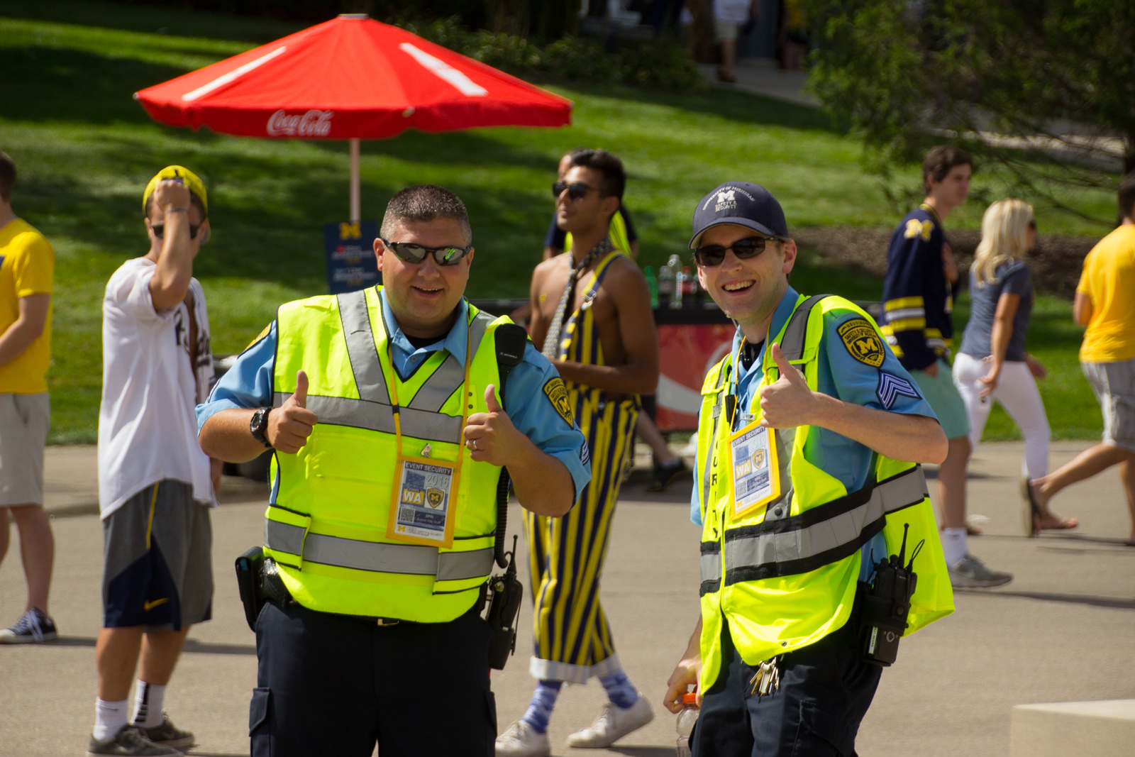 Michigan Medicine Security Sergeant Dillard and Housing Security Sergeant Beers pose for a photo near Gate 10 at Michigan Stadium