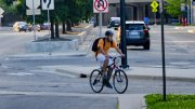 student riding a bike
