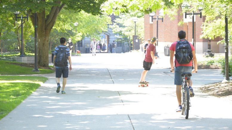 People walking and riding on campus