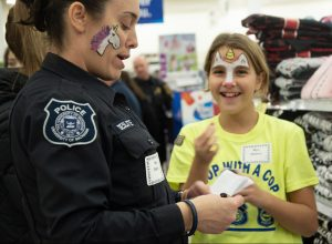 UMPD participates in annual Shop with a Cop event