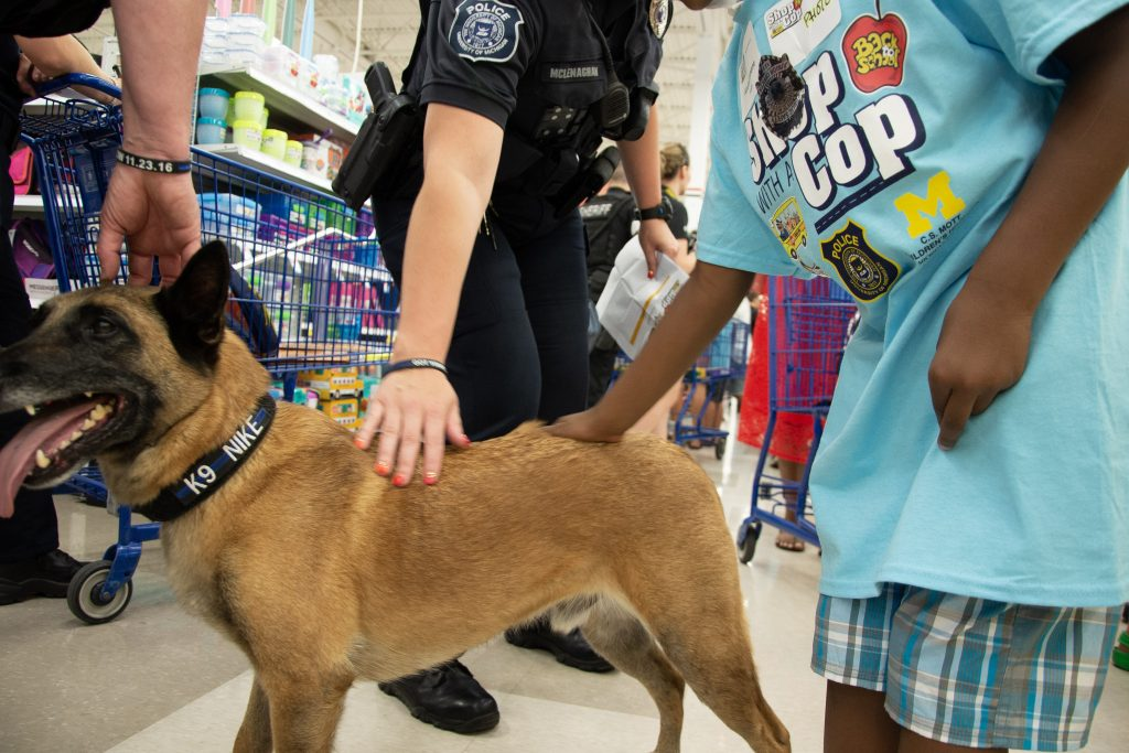 K-9 Nike getting some attention at the 2019 Shop with a Cop - Mott back to school event