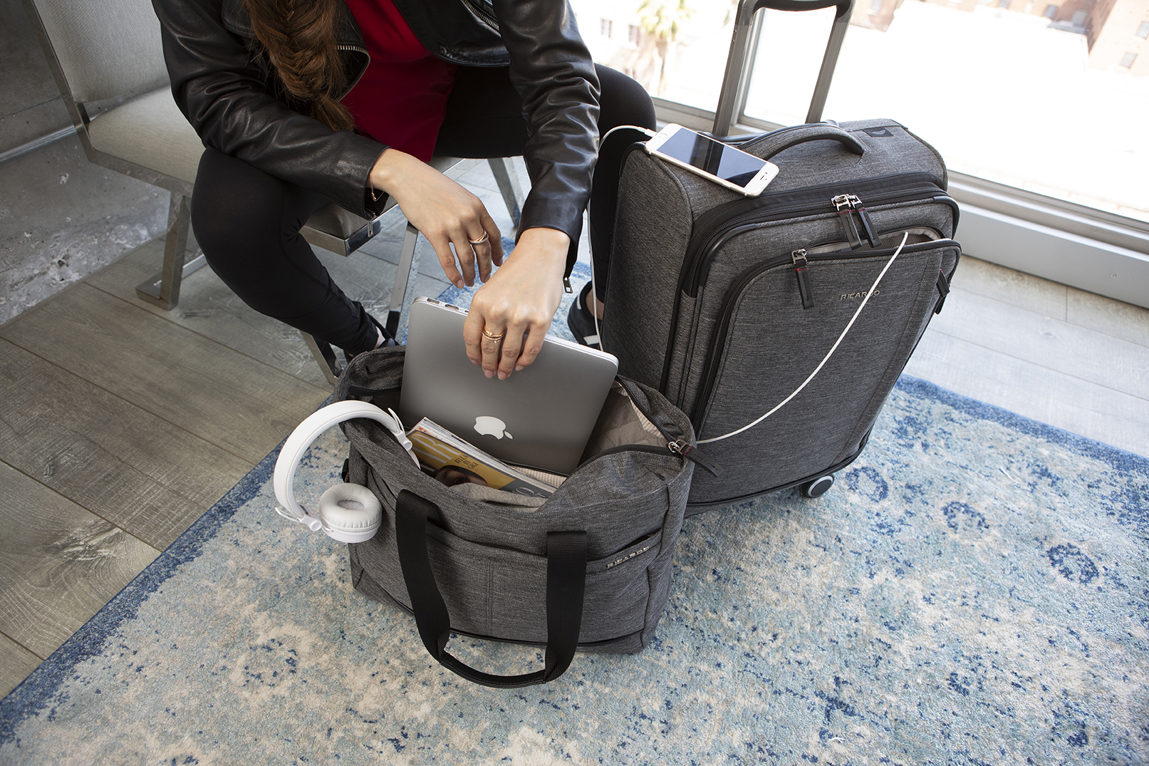 Woman placing laptop inside tote