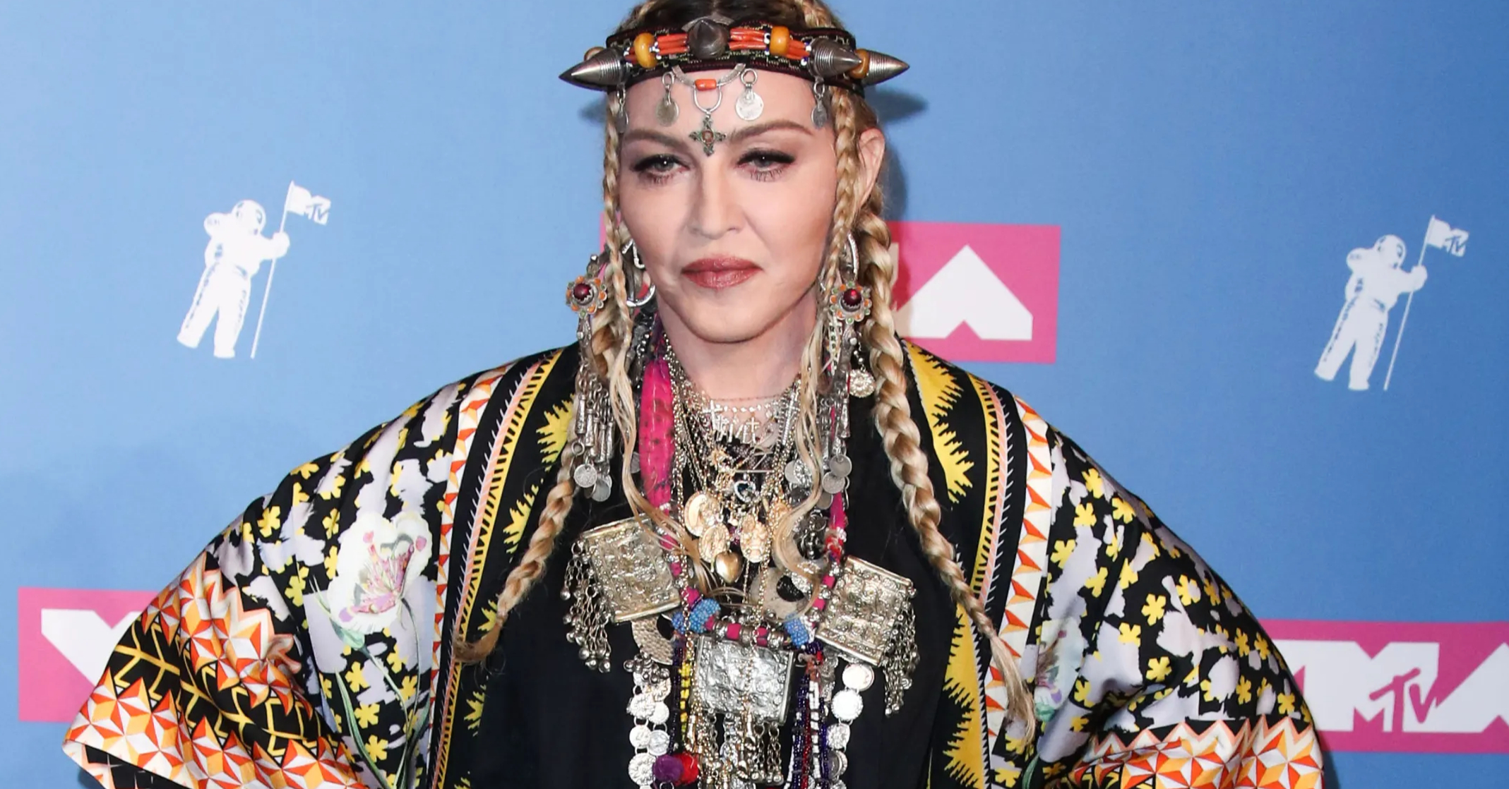 Madonna Inexplicably Posts Photos of Her Daughters While Holding Up a Piece of Watermelon