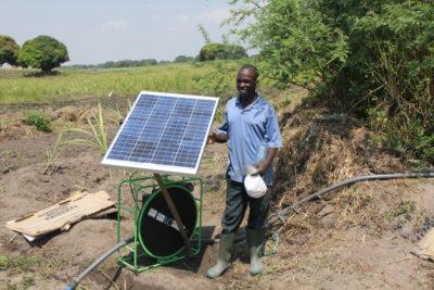 Man W Solar Water Pump Photo By Arne Jacobson