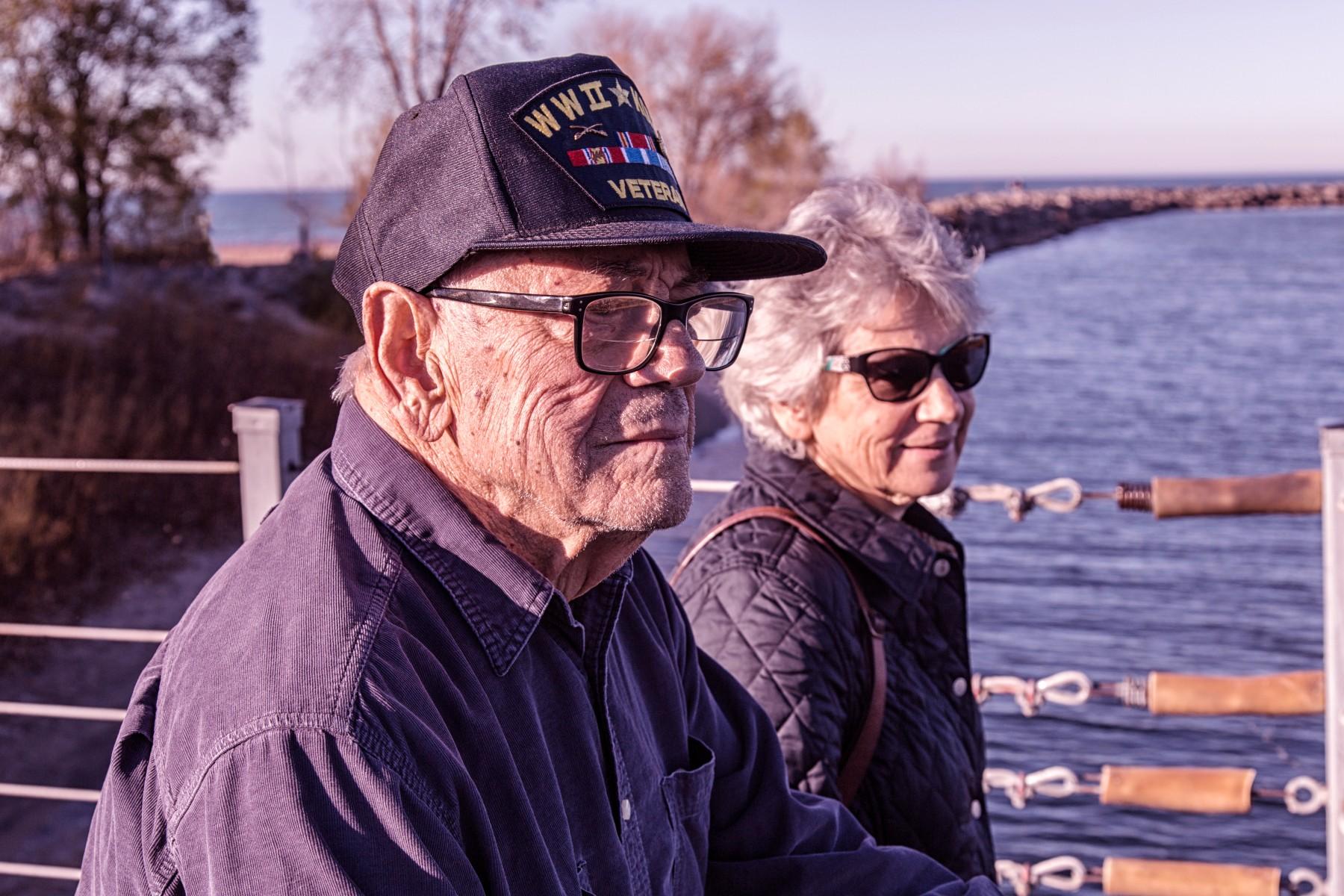Senior Veteran and his wife leisurely watching water